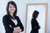 stock photo of pullovers  - Portrait of smiling woman wearing black pullover - JPG