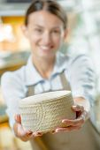 stock photo of meals wheels  - Woman holding a wheel of cheese - JPG