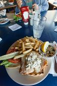 stock photo of french fries  - Fried fish sandwich with tartar sauce and french fries. ** Note: Soft Focus at 100%, best at smaller sizes - JPG