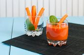 picture of light weight  - Healthy homemade carrot juice in glass and fresh carrots on light wooden background - JPG