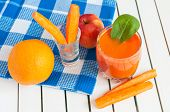 stock photo of light weight  - Healthy homemade carrot juice in glass and fresh carrot - JPG