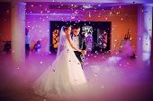 stock photo of romantic  - beautiful romantic first dance by wedding couple - JPG