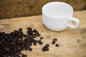 picture of coffee crop  - Coffee beans background on wooden - JPG