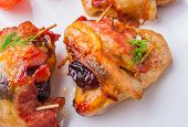 stock photo of plum tomato  - Baked chicken wings with plum on a white plate - JPG