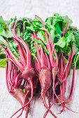 picture of beet  - fresh beet leaves on a white wooden table - JPG