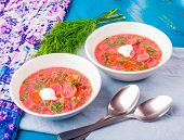 pic of beet  - beet soup with fresh dill on a blue wooden table - JPG