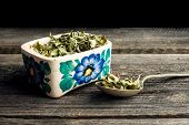 foto of oregano  - dried oregano on old wood background - JPG
