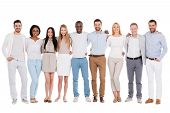 picture of bonding  - Full length of happy diverse group of people bonding to each other and smiling while standing against white background together - JPG