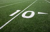 image of ten  - Markings for the ten yard line on an American football field indicate the distance to the goal line - JPG