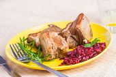 picture of baby back ribs  - roasted ribs wirh beets on yellow plate - JPG