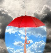 image of rain cloud  - Red umbrella in hand protecting good weather from dark clouds of rain - JPG