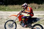 stock photo of moto-x  - Orange and red Motor cross or moto x bike side view at high speed - JPG