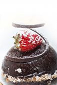 pic of chocolate spoon  - fresh chocolate strawberry mousse over white with silver spoon - JPG