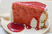 picture of crepes  - crepe cake with strawberry sauce on wooden plate  - JPG