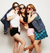 stock photo of swag  - Fashion portrait of three stylish sexy hipster girls best friends - JPG