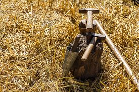 stock photo of scythe  - Hammer and iron tool for sharpening scythe on the tree stump - JPG