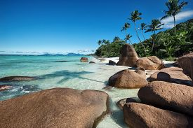 foto of enormous  - Deep blue sky and beautiful beach with enormous stones  - JPG