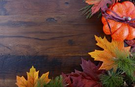 pic of halloween  - Autumn Fall background for Thanksgiving or Halloween with leaves and decorations on rustic wood table with copy space for your text here - JPG