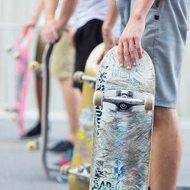 foto of skateboard  - Young skateboarders skateboarding on the street - JPG