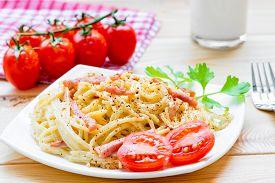 picture of carbonara  - Pasta carbonara on the white plate closeup - JPG