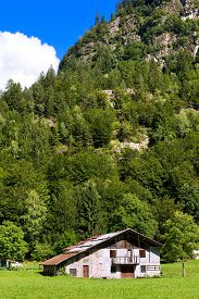 pic of barn house  - Typical old farm house with barn in mountain - JPG