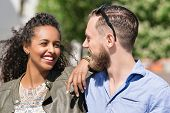 Young Multiracial Couple Looking At Each Other Tenderly poster