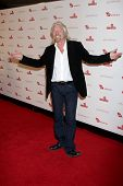 LOS ANGELES - NOV 10:  Sir Richard Branson arrives at the Rock the Kabash Gala 2010 at Dorothy Chand
