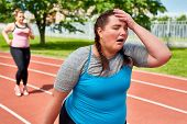 Exhausted runner touching her head with funny facial expression poster
