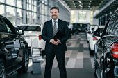 Top sales manager at dealership showroom poster
