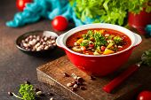 White and red bean soup with vegetables and tomatoes. Vegetarian bean soup for fall and winter seaso poster