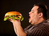 Diet failure of fat man eating fast food hamberger. Breakfast for overweight person who spoiled heal poster