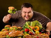 Diet fat man who makes choice between healthy and unhealthy food. Overweight male with hamburgers. T poster