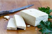 Single Block Of White Tofu With Two Tofu Slices, Crumbs, Fresh Parsley And Rustic Knife On Wooden Ch poster