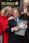 LOS ANGELES -  MARCH 1:  Kirk Douglas (standing) looks on while Maestro Zubin Mehta receives a kiss from his wife at the Hollywood Walk of Fame Star Ceremony honoring him on March 1, 2011 in Los Angeles, CA. Mehta's star is on Vine Street, south of Hollyw