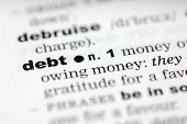 picture of pronunciation  - A close up of the word debt from a dictionary - JPG