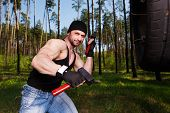 Strong Healthy Adult Ripped Man With Big Muscles Hitting Car Tyr poster