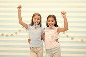 Best Friends. Small Happy Girls Embrace As Best Friends. Friendship Of Small Girls. Meeting With The poster