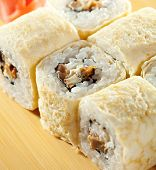 Omelet Maki Sushi - Roll made of Smoked Eel and Cream Cheese  inside. Tamago (Japanese Omelet) outsi