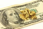 Gold Nuggets And Hundred Dollar Bill