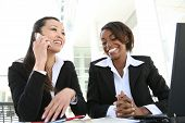 stock photo of asian woman  - An attractive diverse women business team at the office - JPG