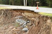 stock photo of landslide  - Broken and damage asphalt road by landslide - JPG