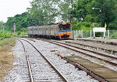stock photo of railcar  - Diesel railcar is going to the platform of station - JPG