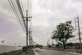 Electricity Pole Against Blue Sky Clouds, Transmission Line Of Electricity To Rural With Green Tree, poster