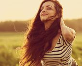 Beautiful Smiling Young Woman Looking Happy With Long Amazing Bright Long Hair On Nature Bright Suns poster