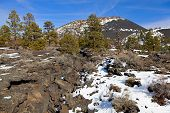 stock photo of scoria  - Sunset Crater in winter - JPG