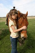 pic of horse girl  - A girl on a spring day on a Texas ranch during a peaceful moment with her horse - JPG