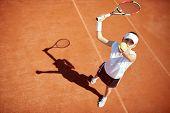 Female tennis player serving tennis ball   poster