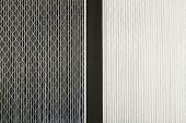 stock photo of furnace  - Close up side by side comparison of a dirty gray home air filter next to a clean white house furnace air filter - JPG