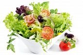 image of vegetarian meal  - Tossed green salad with cherry tomatoes olives fetta cheese red onion cucumber yellow bell pepper and mixed greens - JPG