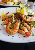 Whole grilled fresh shrimps and vegetables served on a osteria restaurant in Venice, Italy